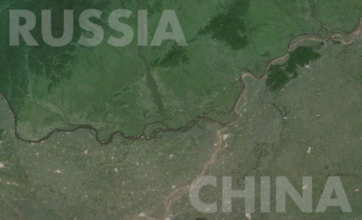 The Amur River Dividing Deserted Russian Siberia From Populous